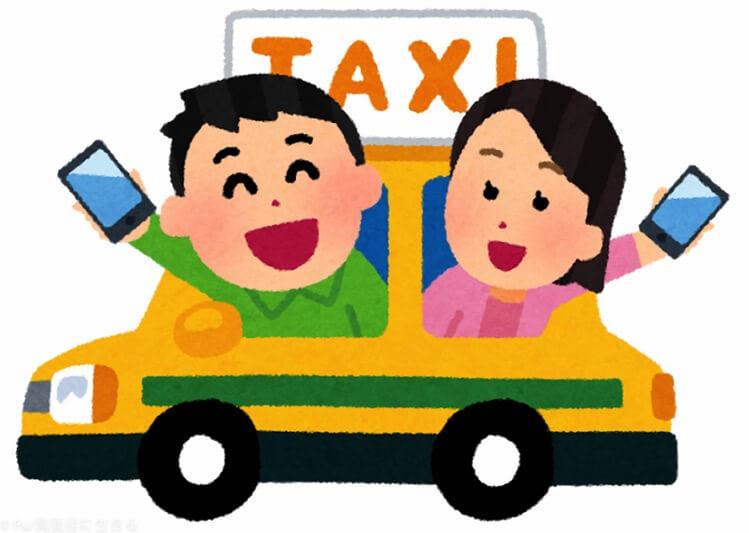 タクシーから乗り出してスマホ